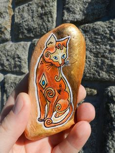 painted cat on rock