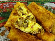 Breakfast Egg Rolls . . . maybe with bacon or ham instead of sausage . . .