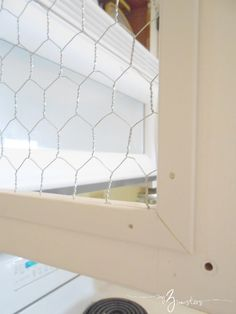 Chicken Wire and White Kitchen Cabinets - use screen molding to cover up rough edges of chicken wire inside cabinet doors