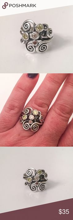 PANDORA Autumn Wind ring - retired. Size 8.5 Beautiful sterling silver ring by PANDORA. Autumn Wind. Has Green, brown and peach stones. Size 8.5. Originally paid $85. I do not have a Pandora box. Will consider reasonable offers. Pandora Jewelry Rings