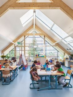 Rotterdam-based architects Kraaijvanger designed a barn-like building to house anursery, classrooms and a gym for the American School of The Hague in Wassenaar.