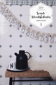 Wie du den skandinavischen Chic auch bei deinem Adventskalender umsetzen kannst - Dank Naturmaterialien und tollen Stoffen ganz einfach.