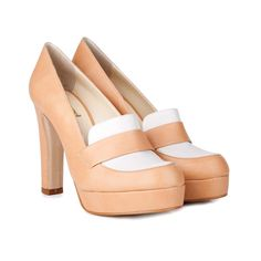 A statement loafer platform style in tan vegan leather & subtle geowhite faux leather we are in love with! All our linings are 100% recycled with a vegetable polymer coating. ♥ Platform of approx 2.5cm ♥︎ Retro block heel height approx 10.5cm. ♥ Breathable 100% recycled lining ♥ Beautifully handmade in Spain. ♥ PETA approved vegan