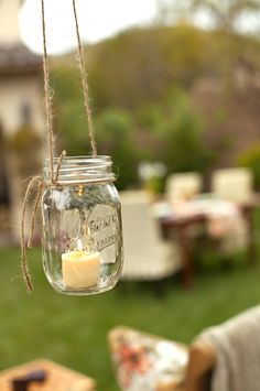 of Fifty July/August 2012 Light up an outdoor party as the sun goes down with tea lights in mason jars, hung by twine. In House of Fifty magLight up an outdoor party as the sun goes down with tea lights in mason jars, hung by twine. In House of Fifty mag Hanging Mason Jars, Mason Jar Candles, Diy Hanging, Hanging Decorations, Hanging Tea Lights, Garden Decorations, Backyard Lighting, Outdoor Lighting, Outdoor Decor