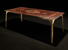 ruben van megen covers tabletops with old persian carpets for his café 6116 collection   Netfloor USA