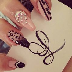 nude and black stiletto nails