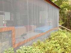 How to create mosquito netting curtains for patioporch make these do it yourself outdoor curtains residential canvas patio porch deck enclosures outdoor curtains solutioingenieria Images