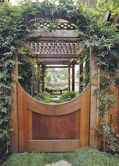 Make the entrance into your garden a breathtaking one by adding an arbor gate that boasts beautiful craftsmanship. This cedar gate has the ability to stop you in your tracks. It separates the garden from the remainder of the yard, and the climbing vines offer a glimpse of the greenery that lies beyond the garden arbor. The perfect craftsmanship beckons all those in the yard to come see what lies beyond the door./