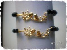 pulsera perla negra y conector pajaritos