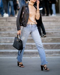 Boyfriend jeans, turtleneck sweater, leather jacket, and lace up heels. So cute.