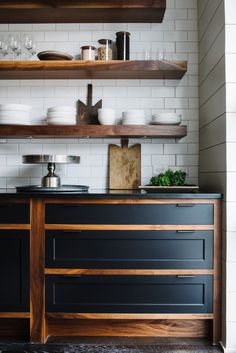If all-dark cabinets are too much for you, try dark doors and drawer fronts set into beautiful timber frames. Via Smith Hanes