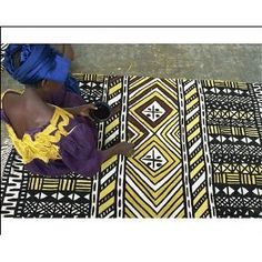 Africa | Making mud cloth.