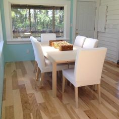 """Need an easy DIY flooring upgrade? Check out Natural Hickory in this customer's dining room! """"We bought this beach house foreclosure with roof water damage. We took out laminate flooring and carpeting from this 12 x 30 room and installed this beautiful natural hickory… Very easy and secure install with nail gun and staples."""" – Mark, DE"""