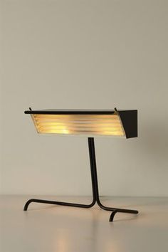 JACQUES BINY Rare table lamp, 1950s  Painted metal, brass. 12 1/4 in. (31.1 cm) high