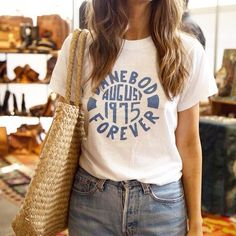 Tee and denim forever ✌️ Street style details at the Fall edition of #acurrentaffair | Photo by Clara Balzary
