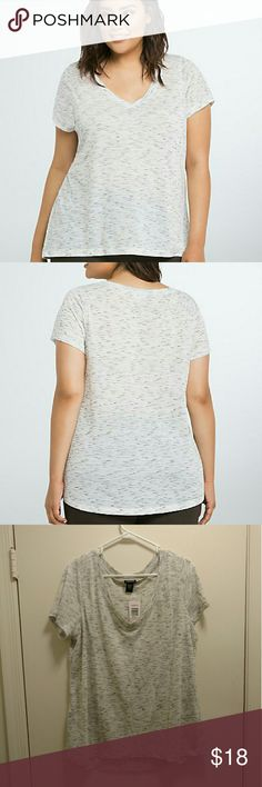 """Torrid Speckled v neck tee NWT - Super soft, speckled v neck tee from Torrid - size 1.  This white slub knit is so lightweight, airy and soft, it feels like an old faithful. The black speckled print however, weaves into the V-neck design, lending an eye-catching and unique touch.  Size 1 measures 28 1/4"""" from Shoulder  Polyester/rayon Wash cold, dry low Torrid  Tops Tees - Short Sleeve"""