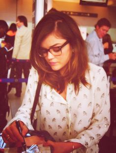Highlights, Short Layered Hair, Button Down Blouse with Bird Pattern, Square Frame Glasses; Lucy Hale.