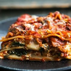 Vegetarian Spinach And Mushroom Lasagna-Have a large crowd gathering for the holidays? Or did you sign up to bring a main dish to a pot luck feast? Consider a lasagna. It's hearty, filling, and feeds a multitude. People will love you if you bring a lasagna.
