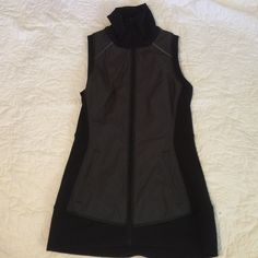 Lululemon vest Lightly used condition, only worn a couple times. Super lightweight and soft! lululemon athletica Tops