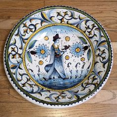 Italian Ceramic Falconry Woman Majolica Bowl - This handmade and hand painted Italian pottery decorative bowl features falconry and flowers in shades of blue, ochre, and sienna on a soft white background. These scenes, reminiscent of pottery from the Italian Renaissance feature idealized, richly attired men and women, often on horseback, representing courtly standards of beauty and virtue. Found at the Italian Pottery Outlet in Santa Barbara, CA.