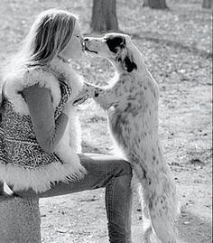Animal lover Brigitte Bardot kisses a pup- love her vest