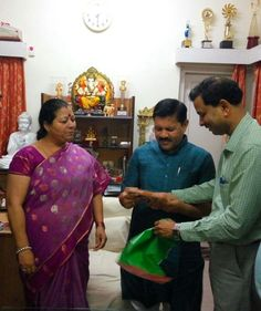 Mohapatra presenting a copy of his new book to BJP stalwart Shyam Jaju