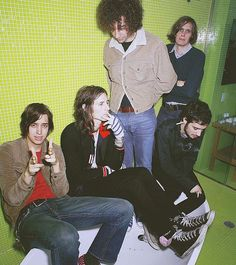 The Strokes. But what's in Fab's ear?