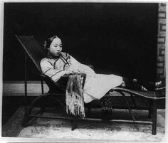 Chinese woman with bound feet reclining