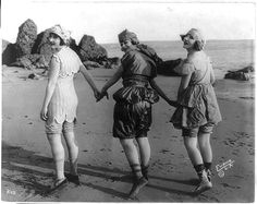 Three bathing beauties with hands joined, wearing vintage bathing suits on beach, Vintage Bathing Suits, Girls Bathing Suits, Vintage Swim, Vintage Bikini, Belle Epoque, Swimming Costume, Flappers, Bathing Beauties, The Bikini