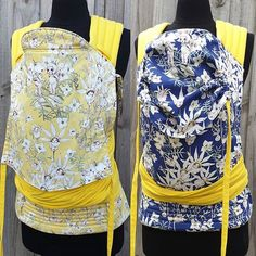 Custom Flannel Flower Babies half buckle with yellow duck canvas straps. This carrier is a standard size (size 2) with padded to wrap straps, leg padding and an adjustable extra long hood. The carrier reverses from a lemon to dark blue May Gibbs print with flannel flower babies peeping from the blossoms as well as cute babywearing boronia babies. #babycarrier #babywearing