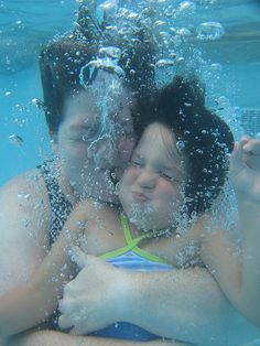 Swimming mother and daughter