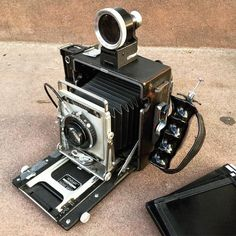 """Belonging to @aleczaballero this is a """"Crown Graphic-Linhof-Voigtlander hybrid: Linhof lefthand grip and optical finder mounted to the wood press camera body and a 150/4.5 Voigtlander Heliar lens dating to 1946 which makes it possible that it was war reparations as the Voigtlander factory survived WWII intact"""". #cameracult #filmcamera #crowngraphic #largeformat #largeformatfilm #cameraporn #speedgraphic #presscamera #voigtlander #heliar #analog #shootfilm #filmisnotdead"""