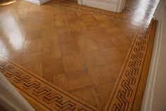Old parquet flooring installation with a border inlay.