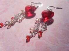 Perfect for Valentine's day, or anyone who's a lover! Silver chain with pink, red and clear crystals cascade down from red crystal hearts. https://www.etsy.com/shop/AurosCrafts?section_id=13237979&ref=shopsection_leftnav_5