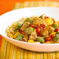 The pork shoulder gets extra tender in the slow cooker. Sweet peppers and okra add to this dish, which is served on brown rice to make a complete meal.