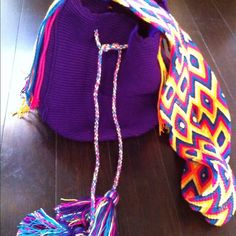 JUST LOWERED! Wayuu Mochila Bag  -never used! GORGOUS, brand new never used Wayuu Mochilla Bag! Bright purple bag with multi-color braided strap, and tassels. Bags have been featured in Vouge & various Style Magazines! Perfect for all your Summer outings! Wayuu Mochila Bag Bags