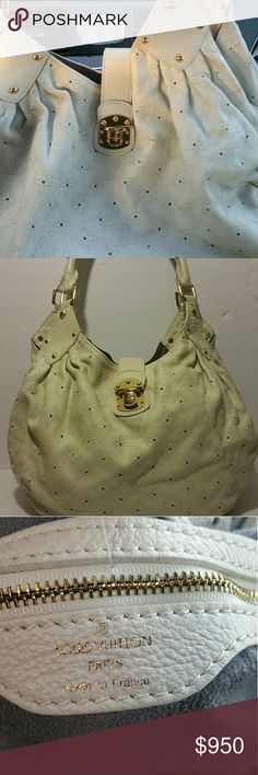 Louis Vuitton Surya Authentic Beautiful cream-colored leather purse in great condition.  Has a small pea-sized mark on very bottom of purse, not noticable. Louis Vuitton Bags Hobos