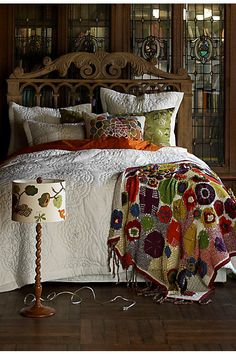 Great idea for stitching recycled fabric stitched to a blanket (although this one is crocheted/knitted)