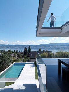 Overlooking Lake Zurich. Feldbalz Residence. Architect: Gus Wüstemann.