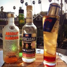 THE LAND MINE:  1/2 oz. (15ml) Orange Vodka 1/2 oz. (15ml) Sour Apple Pucker 1/2 oz. (15ml) Creme de Bananas 1/2 oz. (15ml) Everclear Splash of Grenadine Can of Red Bull