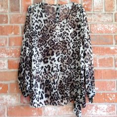 """Sheer Animal Print Top Plus Size This shirt is NWOT. In excellent condition. It does need a cami worn underneath it. It measures 251/2"""" underarm to underarm and is 30"""" long Dress Barn Tops Blouses"""