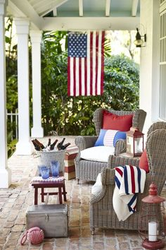 Coastal patio with red, white and blue decor and an American flag hanging