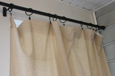 curtians made from a canvas dropcloth. walmart has the 9x12 painters dropcloth in the paint section for 9.98. cut in half for 2 panels, then add curtain clips (also at walmart for 3.97). NO-SEW, quick and easy.