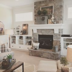 White plank walls surround this stone fireplace for a fresh, modern farmhouse look. Interior design by Janna Allbritton of Yellow Prairie Interior Design.