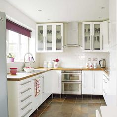 White Kitchen: A chic looking kitchen in neutrals and white. Free-standing cabinets.