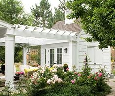 It would be neat to do a pergola off the side of the detached cottage! (If would attached the the side that is down-slope, toward the barn and garden area.