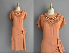 vintage 1940s dress / 40s rayon beaded cutout neckline vintage dress by simplicityisbliss on Etsy https://www.etsy.com/ca/listing/469982786/vintage-1940s-dress-40s-rayon-beaded