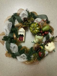 Some lace ribbon and burlap with some gourds gives this wreath a rustic look for fall