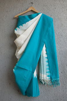 This cotton handwoven saree is extremely comfortable, from West Bengal. The color combination is rich and elegant. The warp yarns are from mills while the weft
