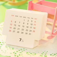 http://g01.a.alicdn.com/kf/HTB10QBeIXXXXXXZXFXXq6xXFXXXS/Novelty-DIY-Paper-Chair-Design-Table-Calendar-Desktop-Calendar-School-Office-Supply-XX1.jpg